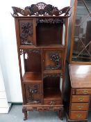 A GOOD QUALITY ORIENTAL HARDWOOD CARVED CABINET.