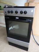 A GAS/ELECTRIC COOKER.