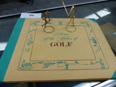 GOLF RULE BOOKS TOGETHER WITH TWO HOBBNAIL FIGURES OF GOLFERS.