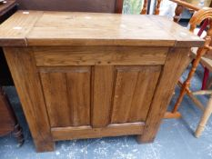 A SMALL OAK PANEL FRONT COFFER.