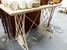 A MARBLE TOPPED IRON BASE TABLE.
