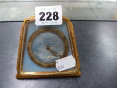 A SWISS MADE MOTHER OF PEARL DIAL TRAVEL CLOCK.