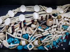 A SELECTION OF ETHNIC BONE AND TURQUOISE BEADS, ETC.
