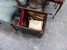 A MINIATURE CARVED OAK COFFER AND A COLLECTION OF VINTAGE HANDBAGS.