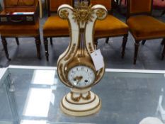 FRENCH ORMOLU MOUNTED MARBLE LYRE FORM CLOCK.