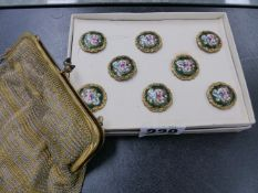 EIGHT ENAMELLED BUTTONS TOGETHER WITH A WHITE METAL PURSE.
