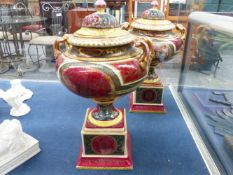 A PAIR OF PORCELAIN URNS IN THE SEVRES MANNER.