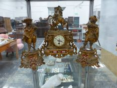 A GILT SPELTER FRENCH CLOCK GARNITURE WITH SEVRES TYPE PORCELAIN PLAQUES.