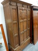 A SHAPLAND & PETTER ARTS AND CRAFTS OAK WARDROBE.