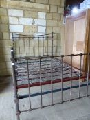 AN ANTIQUE BRASS DOUBLE BED.