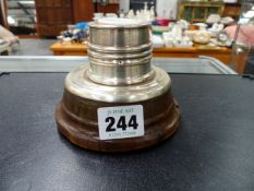 A HALLMARKED SILVER INKWELL ON HORN BASE.