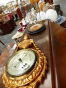 A BAROMETER AND A GLASS DOME ON STAND.