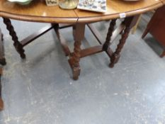AN OAK BARLEY TWIST DROP LEAF TABLE.