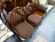 A SET OF FOUR ERCOL DINING CHAIRS AND TWO OTHERS.