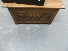 A SMALL CARVED OAK COFFER.