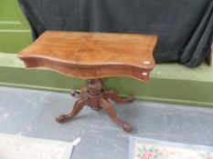 A VICTORIAN WALNUT FOLD OVER CARD TABLE.
