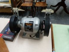 A BENCH GRINDER AND A MULTI METER.