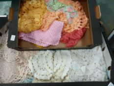 TWO BOXES OF HAND CROCHET DOILIES.