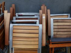 A SET OF EIGHT FOLDING PATIO CHAIRS.