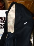 A WOOLEN HUNT JACKET ON GOOD CONDITION.