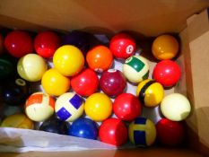 A SET OF POOL BALLS AND CUES.