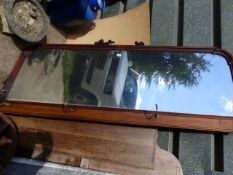 A CARVED MAHOGANY HALL MIRROR