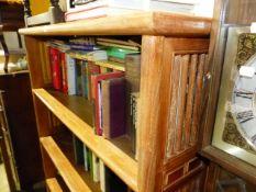 A LARGE HARDWOOD BOOKCASE.