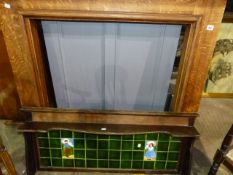 AN OAK FIRE SURROUND AND AN ART NOUVEAU TILED BACK WASHSTAND.