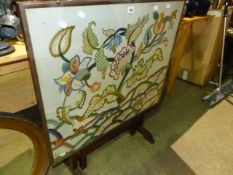 A FOLDING TABLE WITH NEEDLEPOINT TOP.