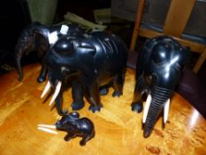 A FAMILY OF EBONY ELEPHANTS.