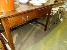 AN ANTIQUE OAK TWO DRAWER SIDE TABLE.