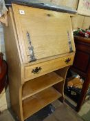 AN ARTS AND CRAFTS OAK BUREAU.