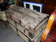 A VINTAGE DOME TOP TRAVEL TRUNK.