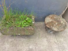 A SMALL STONE TROUGH AND A SMALL STADDLE STONE.
