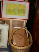 A WICKER BASKET AND A SMALL QTY OF PICTURES.