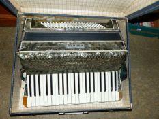 A HOHNER PIANO ACCORDIAN.