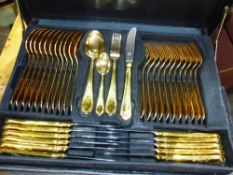 A GOOD QUALITY GERMAN STEEL AND GOLD PLATED CUTLERY SERVICE.