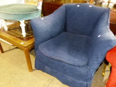 A VINTAGE BLUE UPHOLSTERED ARMCHAIR, A COFFEE TABLE AND A STANDARD LAMP