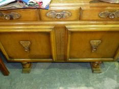 AN ART DECO OAK SMALL SIDEBOARD.