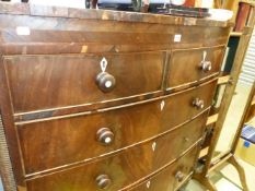 A VICTORIAN BOW FRONT CHEST OF DRAWERS.
