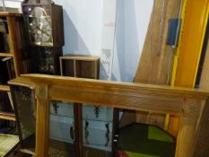 A RETRO LONG CASE CLOCK, A SIMILAR DISPLAY CABINET, A FIRE SURROUND,ETC.