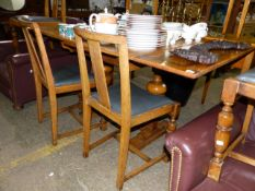 AN ART DECO DRAWER LEAF DINING TABLE AND FOUR CHAIRS.