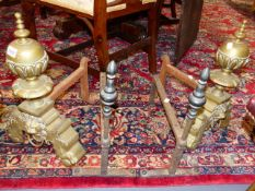 A PAIR OF HEAVY BRASS 17th.C.STYLE ANDIRONS AND A PAIR OF BRONZE MOUNTED IRON FIRE DOGS.
