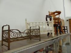 AN ANTIQUE IRON DOLL'S BED, THREE DOLL'S CHAIRS, A ROCKING CRADLE AND A SMALL PAINTED BIRDCAGE