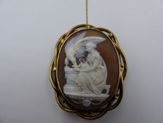 A VICTORIAN LARGE CARVED CAMEO DEPICTING HEBE FEEDING THE EAGLE OF ZEUS, MOUNTED IN A PRECIOUS