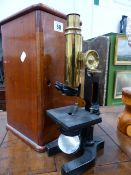 AN EARLY 20th.C.MONOCULAR MICROSCOPE BY BAUCHE & LOMB IN A MAHOGANY CASE.