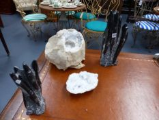 A LARGE CRYSTAL CENTRED GEODE SPECIMEN AND TWO POLISHED FOSSIL SCULPTURES.