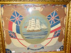 A VINTAGE WOOLWORK PANEL OF A SAILING SHIP SURROUNDED BY FLAGS AND ENTITLED HOMEWARD BOUND. 47 x