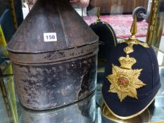 A VICTORIAN MILITARY BLUE CLOTH HELMET WITH GILT BRASS PLATE AND SPIKE FINIAL COMPLETE WITH METAL