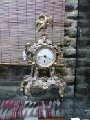 AN 18th.C.CARVED GILTWOOD CASED MANTLE CLOCK SURMOUNTED WITH EAGLE FIGURE, SINGLE TRAIN FUSEE